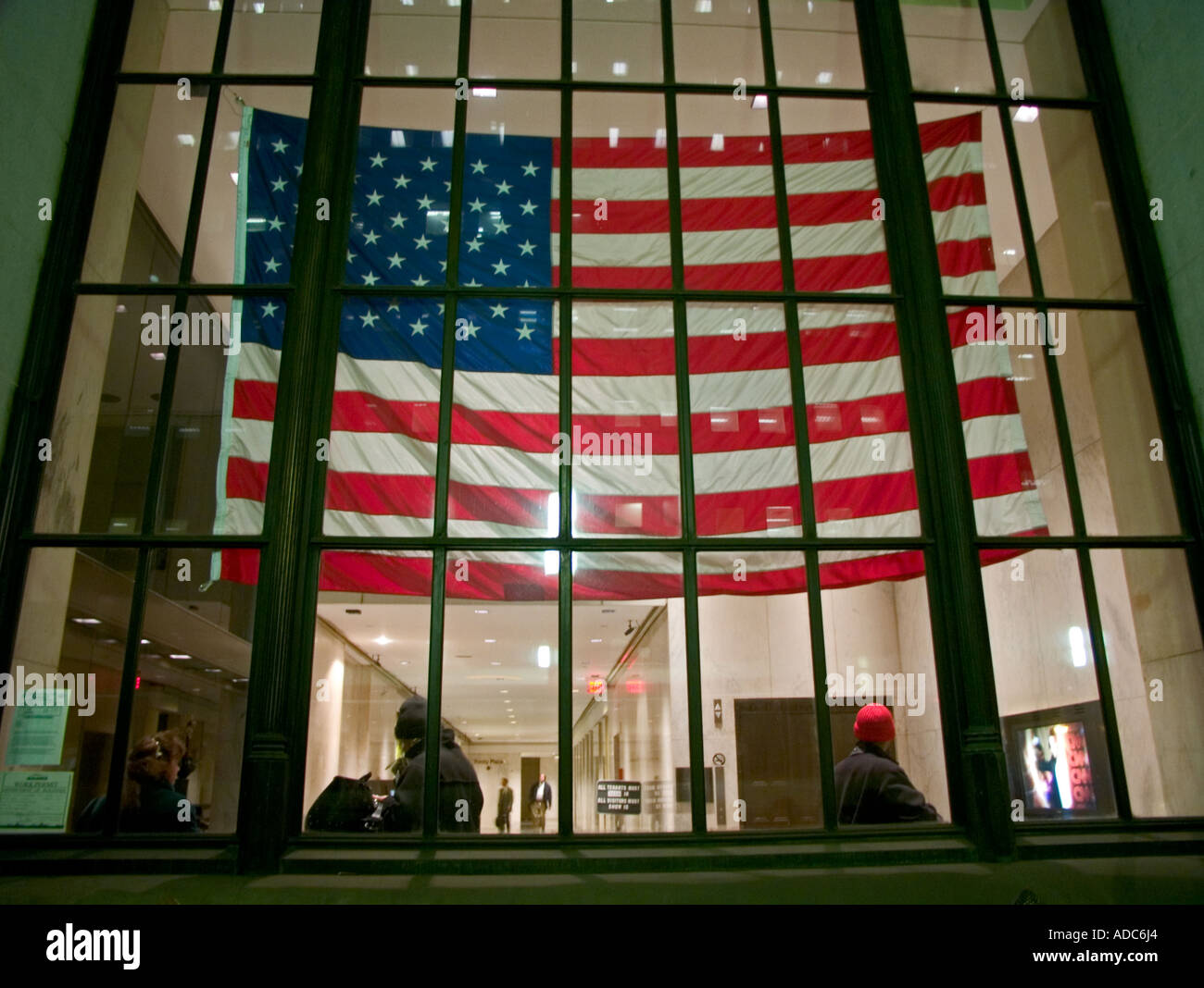 american flag hanging in large post office window  in new york - Stock Image