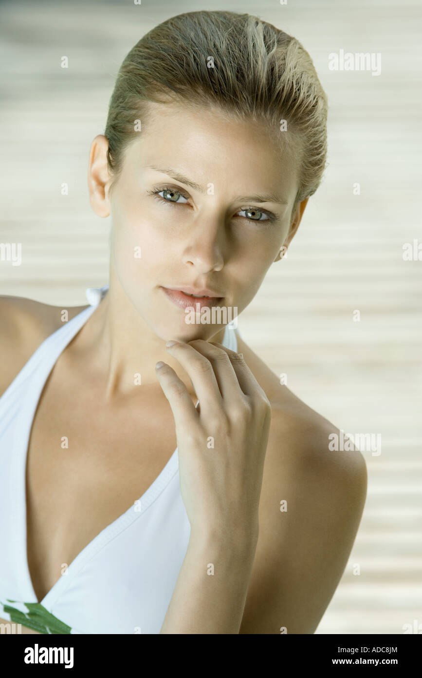 Woman wearing halter bathing suit, head and shoulders, portrait, high angle view - Stock Image