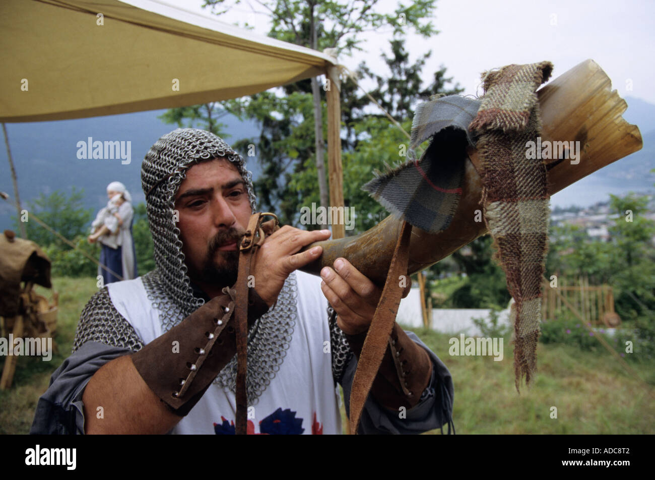 A horn blower during the traditional historic evoking of the Middle Ages in Sale Marasino, Italy - Stock Image