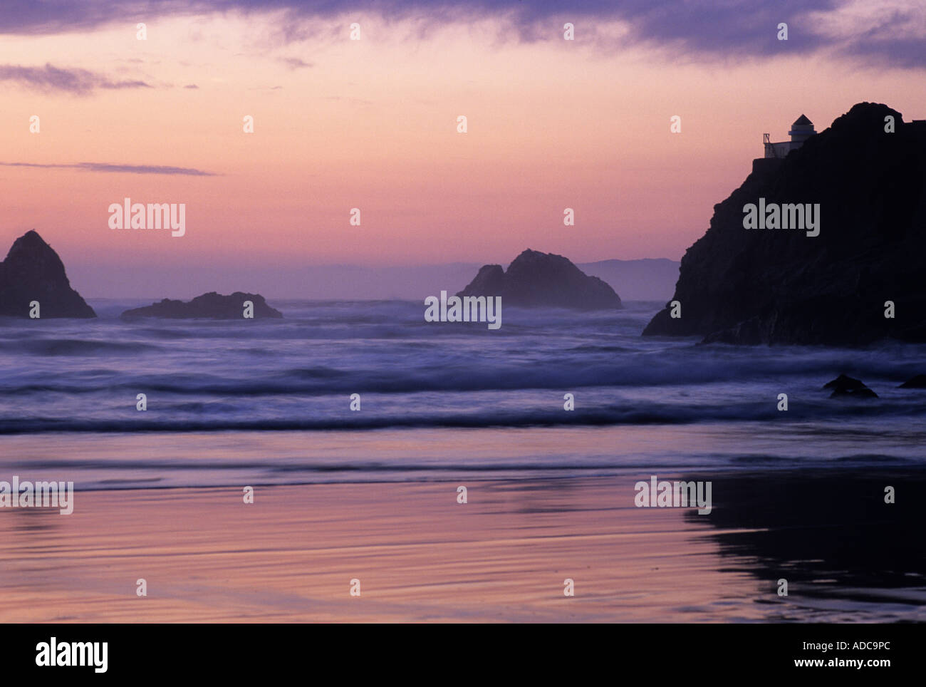 Ocean Beach and Seal Rocks during dusk Golden Gate National Recreation Area San Francisco California USA - Stock Image