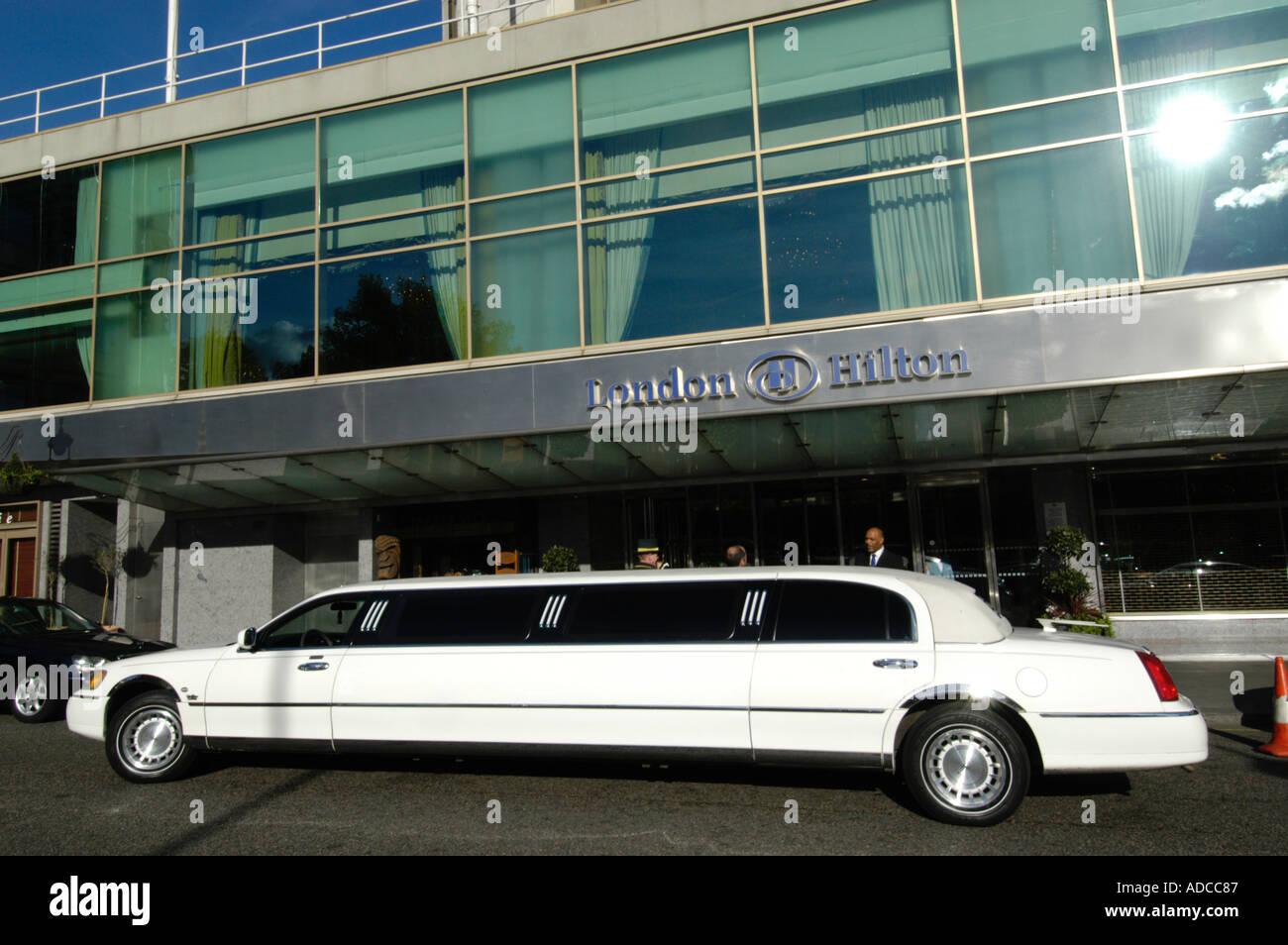 White stretch limousine at the London Hilton Hotel Mayfair England UK - Stock Image