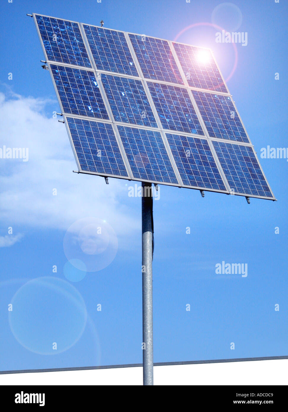 SOLAR electric panel power and relection reflexion  sun energy blue sky - Stock Image