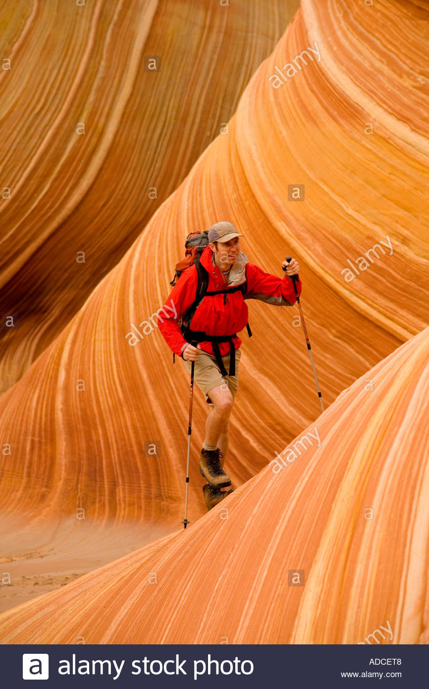 Hiker in The Wave Coyote Buttes Wilderness Area Arizona - Stock Image