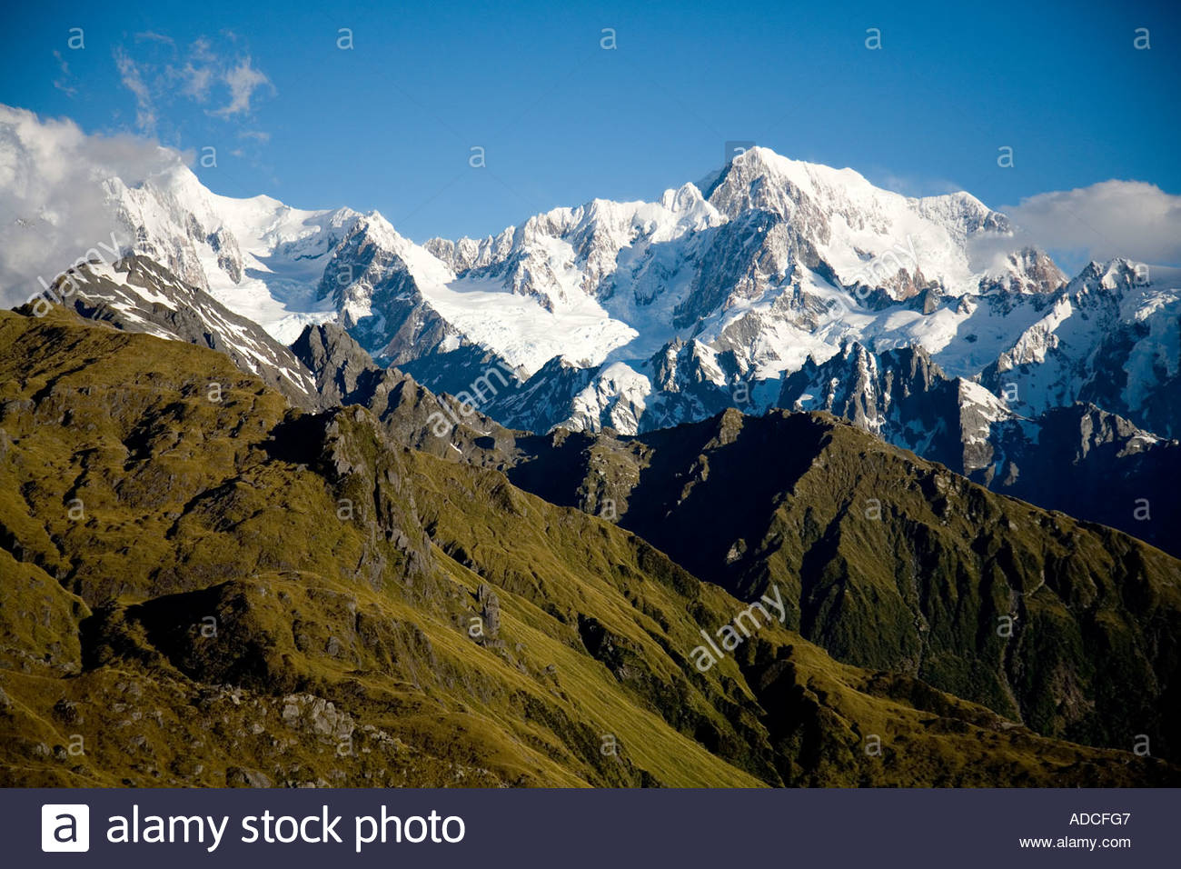 Clouds hover around Mt Cook in late afternoon Southern Alps New Zealand - Stock Image