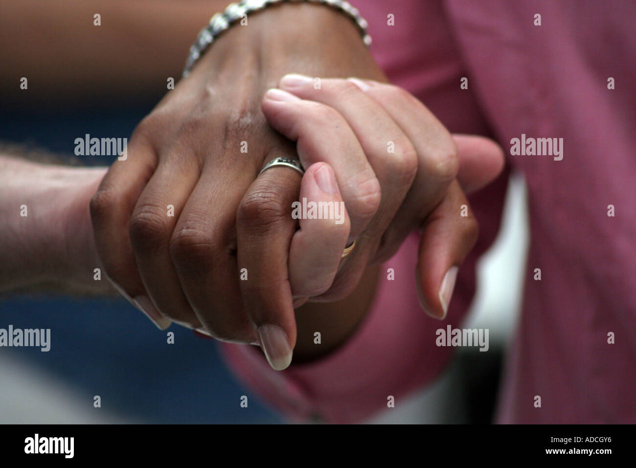 Interracial hand holding
