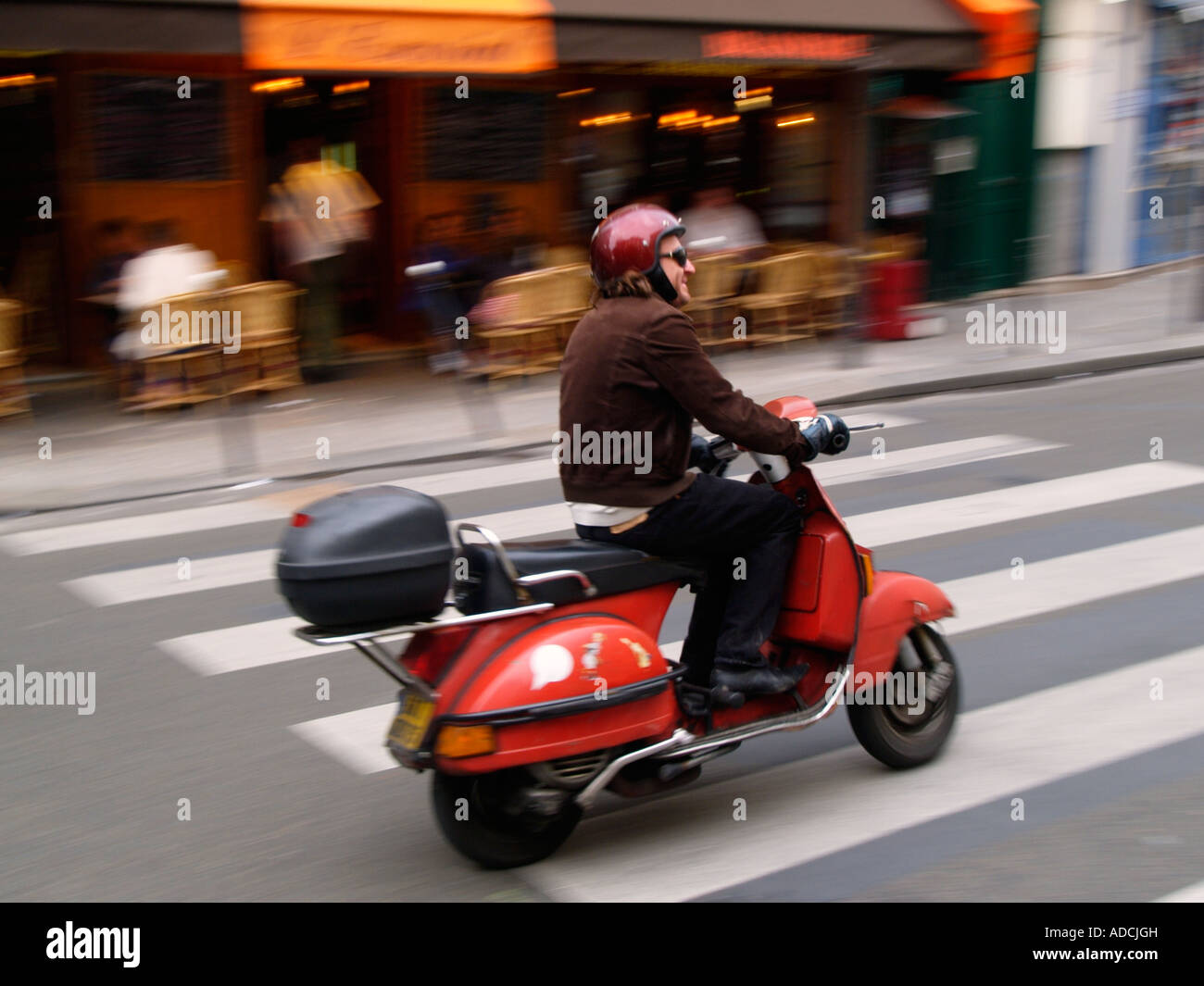 man riding his red classic vespa scooter in the le marais quarter stock photo 13378144 alamy. Black Bedroom Furniture Sets. Home Design Ideas