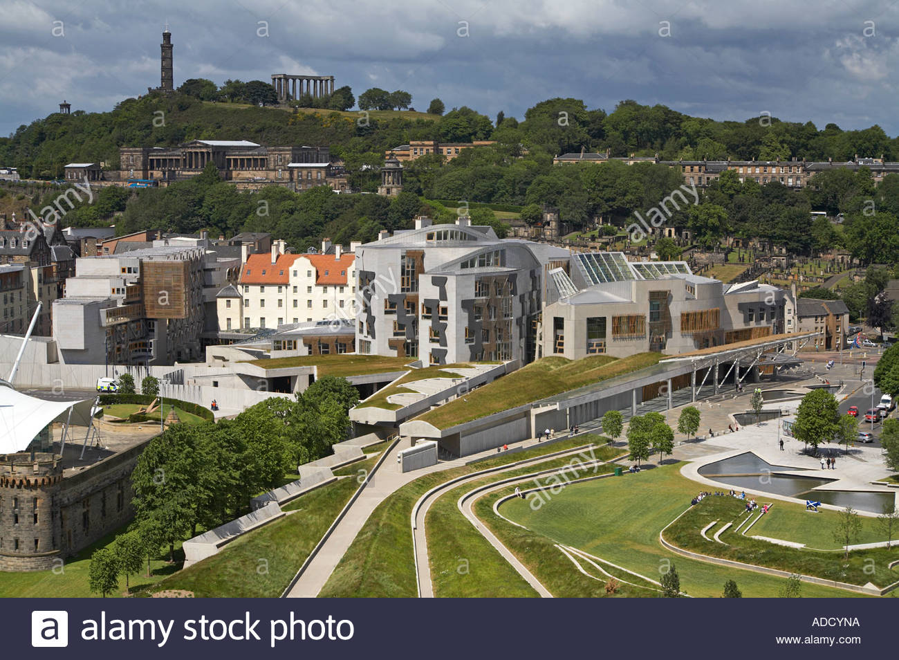 A view of the Scottish parliament, with Calton hill in the background Stock Photo