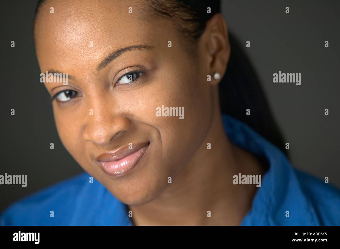 Late twenties African American black female portrait smiling - Stock Image