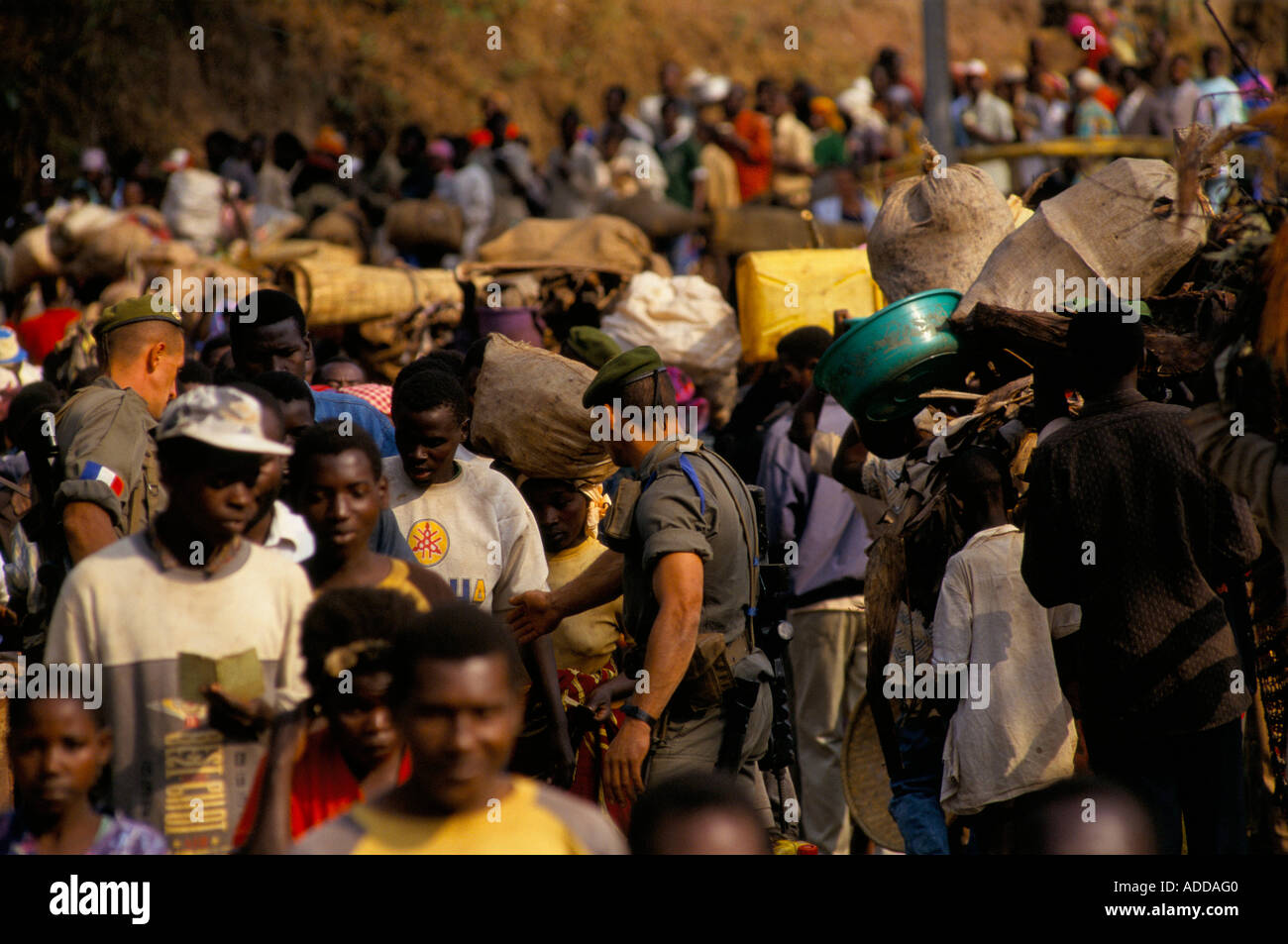 French soldiers a few days before their departure monitor the flow of Rwandan refugees across the bridge at Bukavu into Zaire. - Stock Image