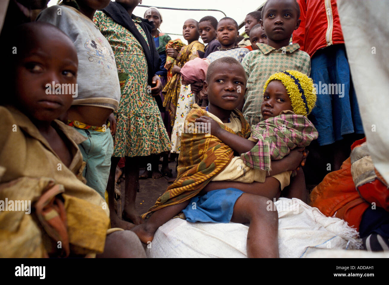 Hutu children returnees from camps in Zaire arriving at a way station on the way to Kigali, the Rwandan capital. - Stock Image