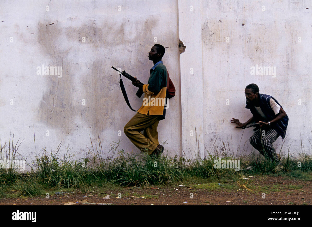 Ulimo J Faction guns at the ready advance from their base in downtown Monrovia to engage Charles Taylor s NPFL fighters - Stock Image