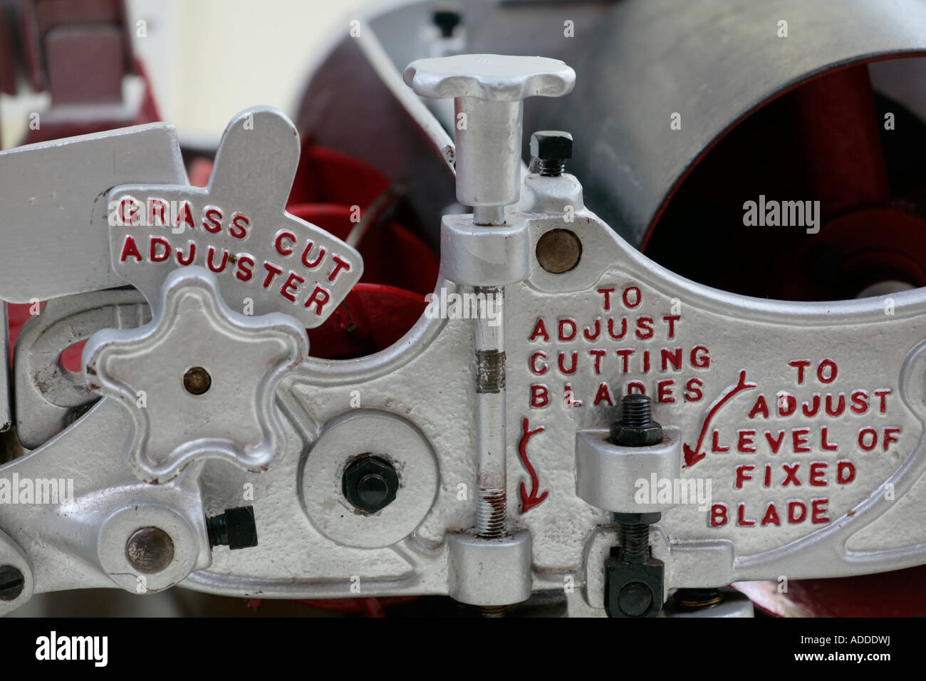 Close up of parts of an old fashioned push lawnmower - Stock Image