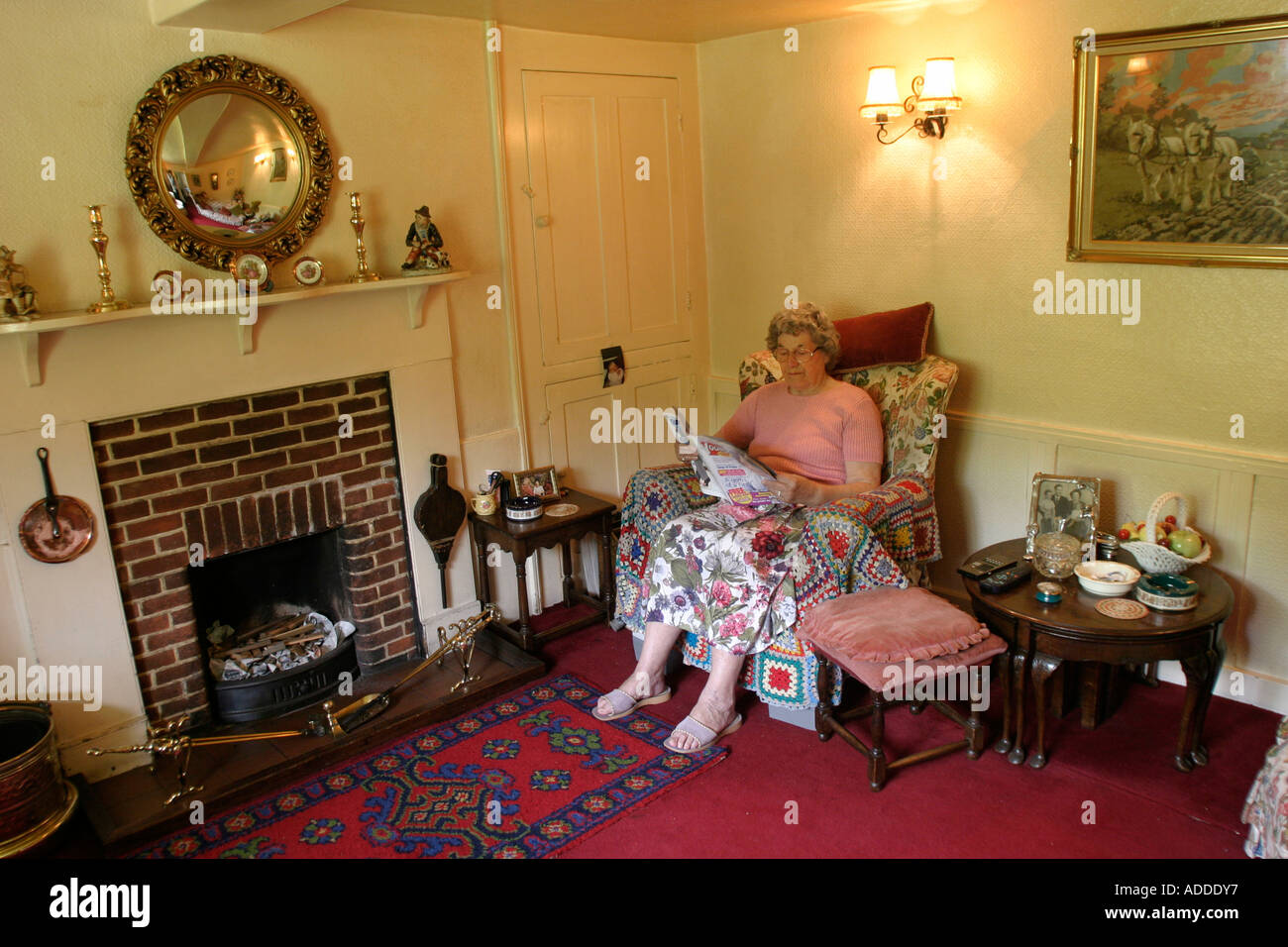 Mille in her sitting room.  Millie, 78 ,has lived in Hambleden village most of her life. - Stock Image