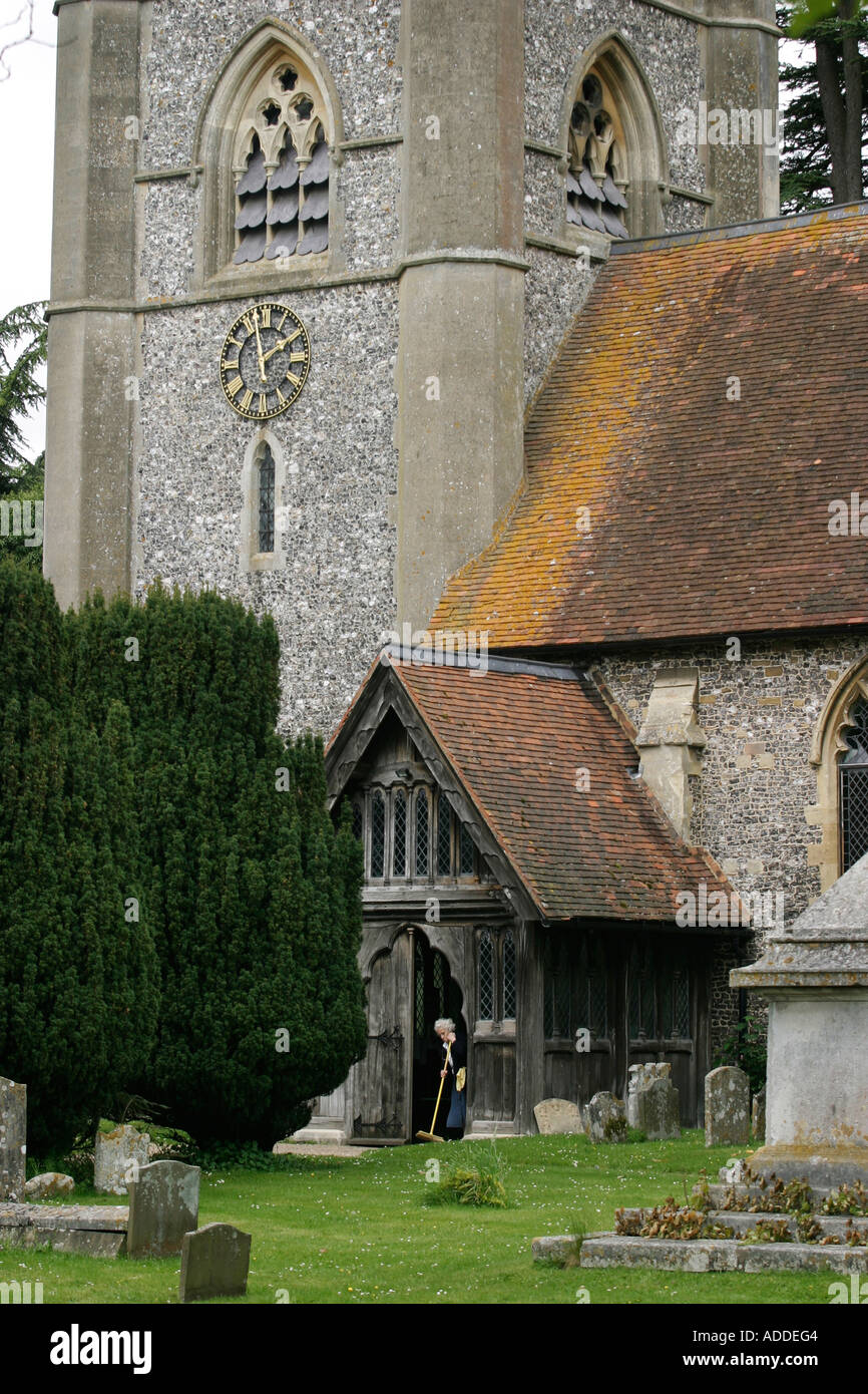 Cleaning the entrance to Hamblen's gothic St Mary the Virgin church. Hambleden village is in the heart of the Chilterns. - Stock Image