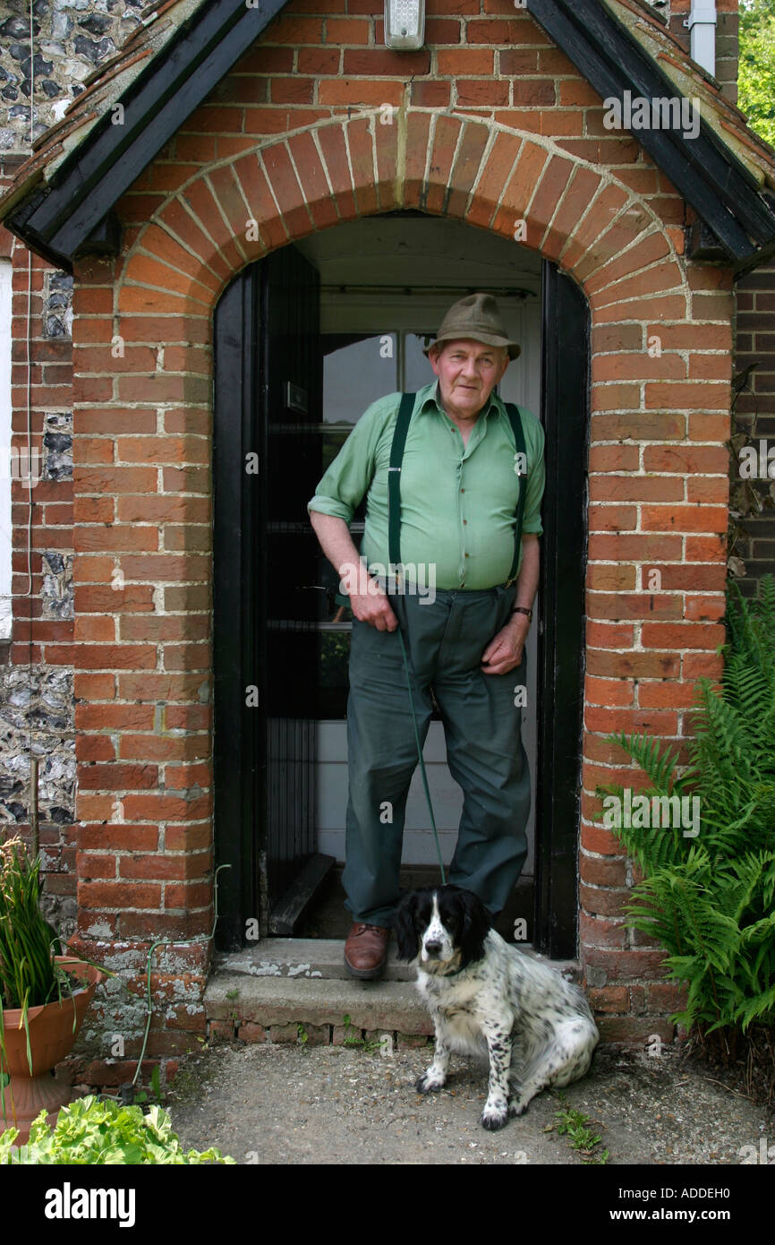 Alan Butler, 75, retired gamekeeper with his dog Ben.  His father and his grandfather were gamekeepers before him. - Stock Image