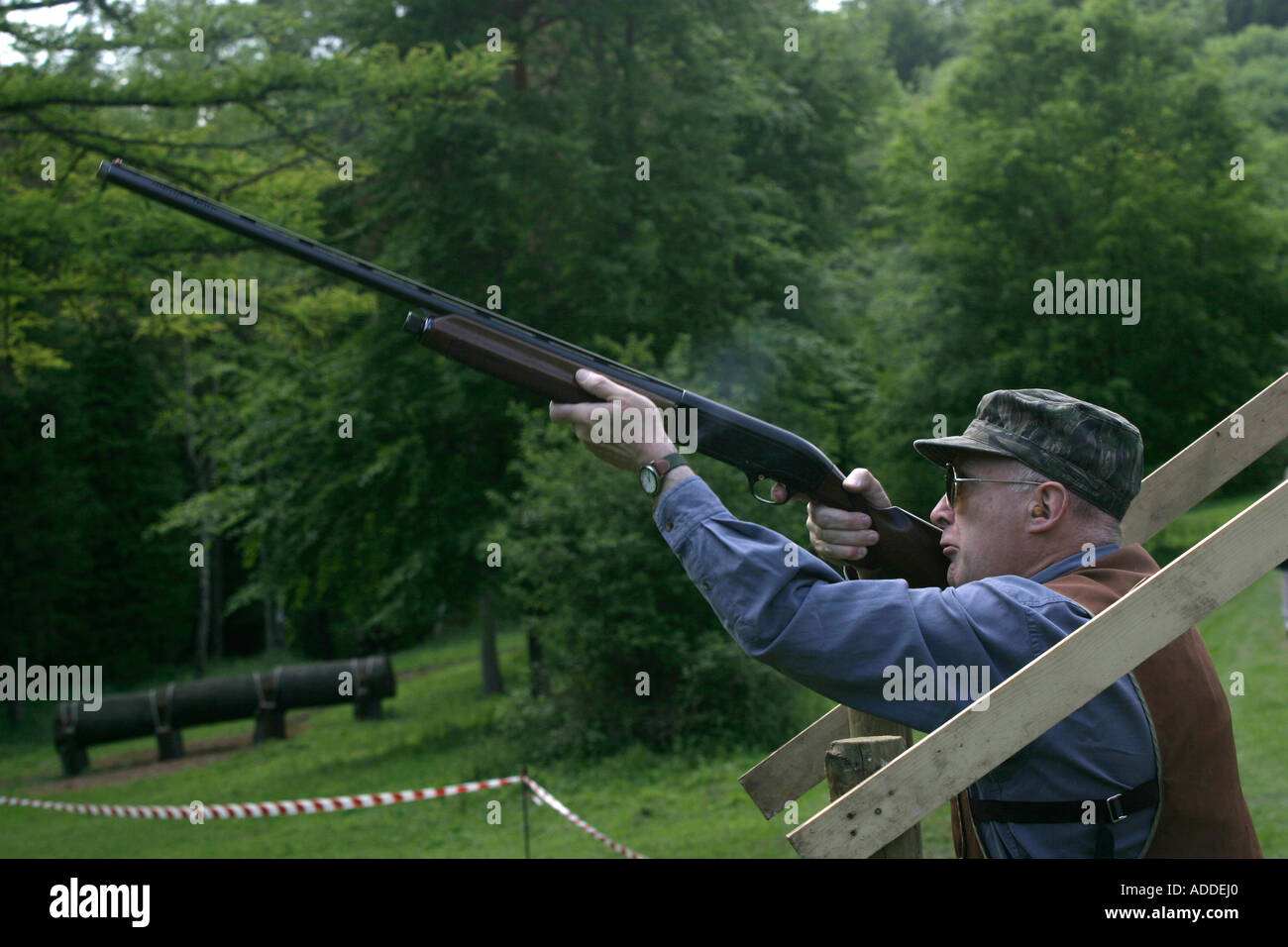 Taking aim with a shotgun  This clay pigeon shoot was