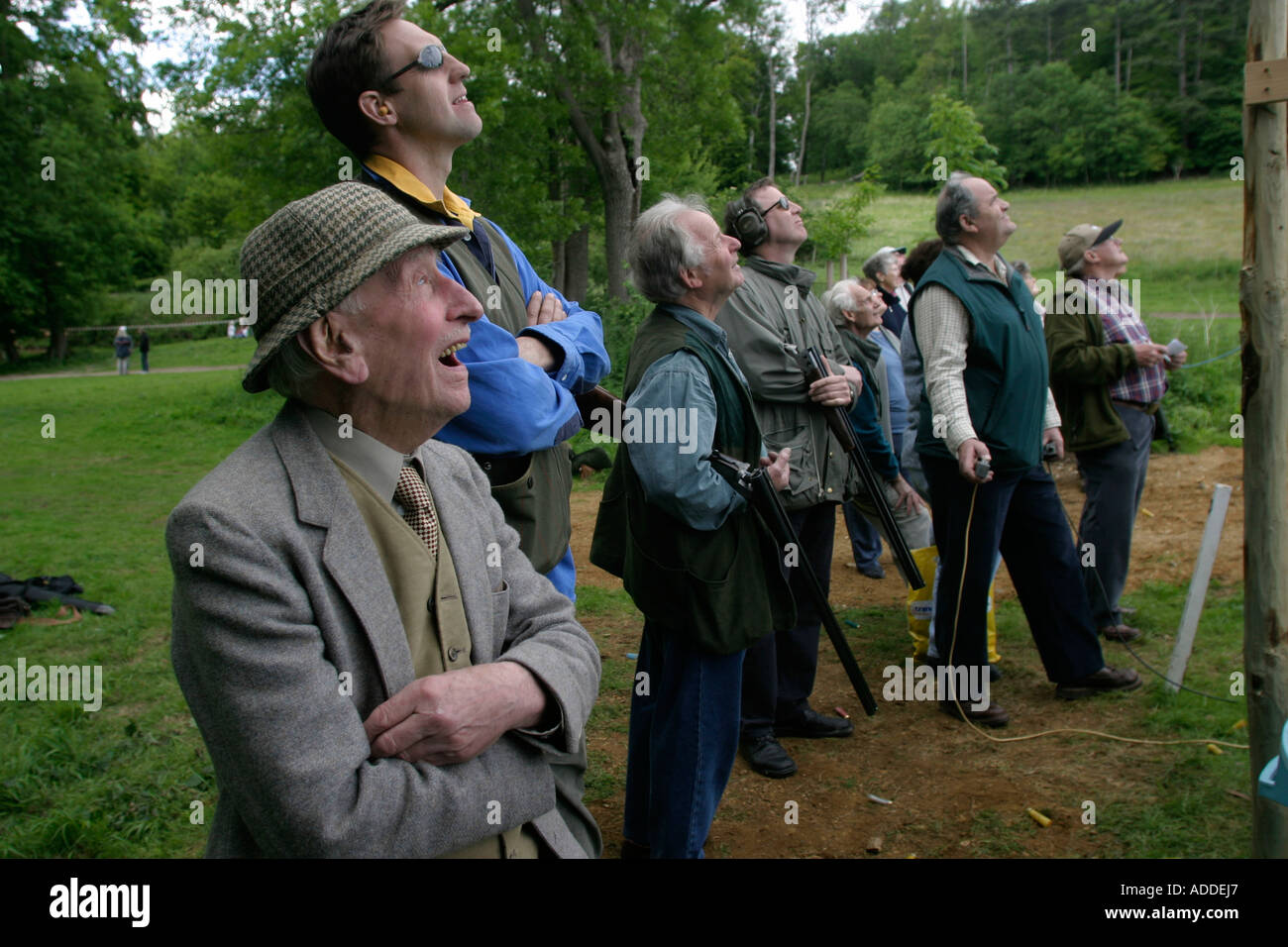 Old George and others watching the clay pigeon shoot organised by the Hambleden estate to thank its beaters for last season. - Stock Image