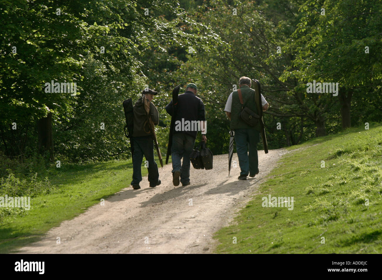 walking back after shoot. This clay pigeon shoot was organised by the Hambleden Estate to thank beaters for work last season. - Stock Image