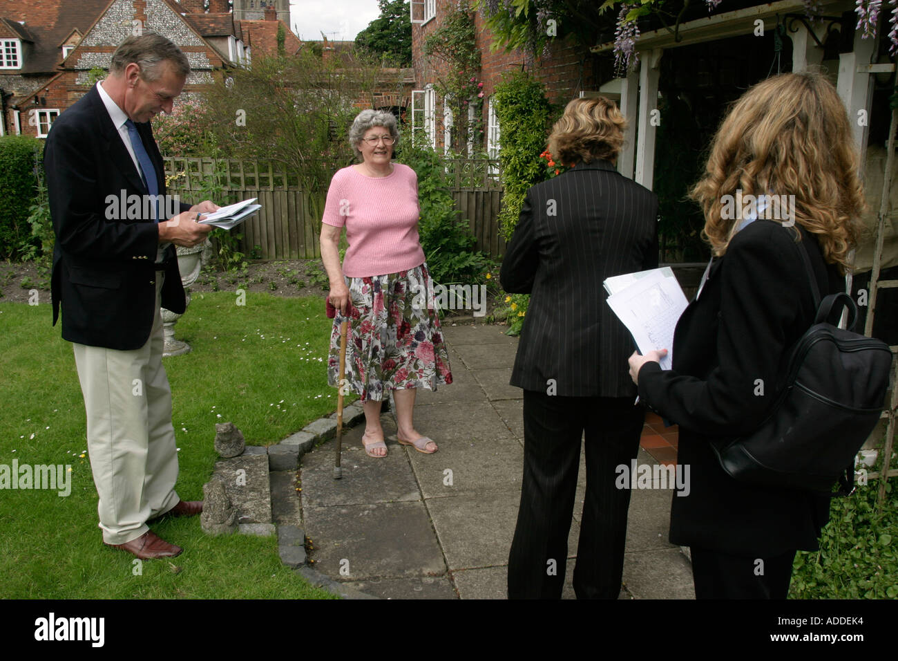 Estate agents show a viewer representing an un-named potential buyer (left) some of the properties of Hambleden village - Stock Image