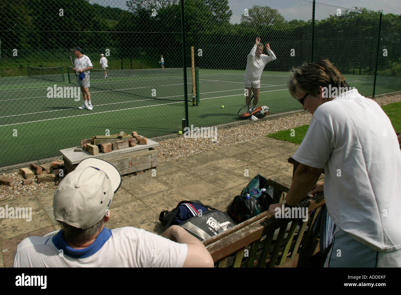 Tennis club meet frequently at the courts beside the Hambleden's playing fields. - Stock Image