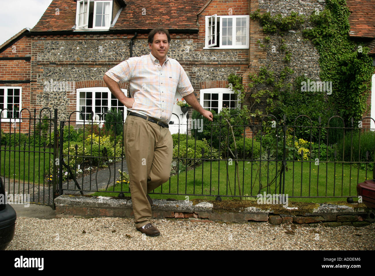 Hambleden:  Henry Smith, 48,  heir to Viscount Hambleden, in front of one of the village houses. He is selling the estate. - Stock Image