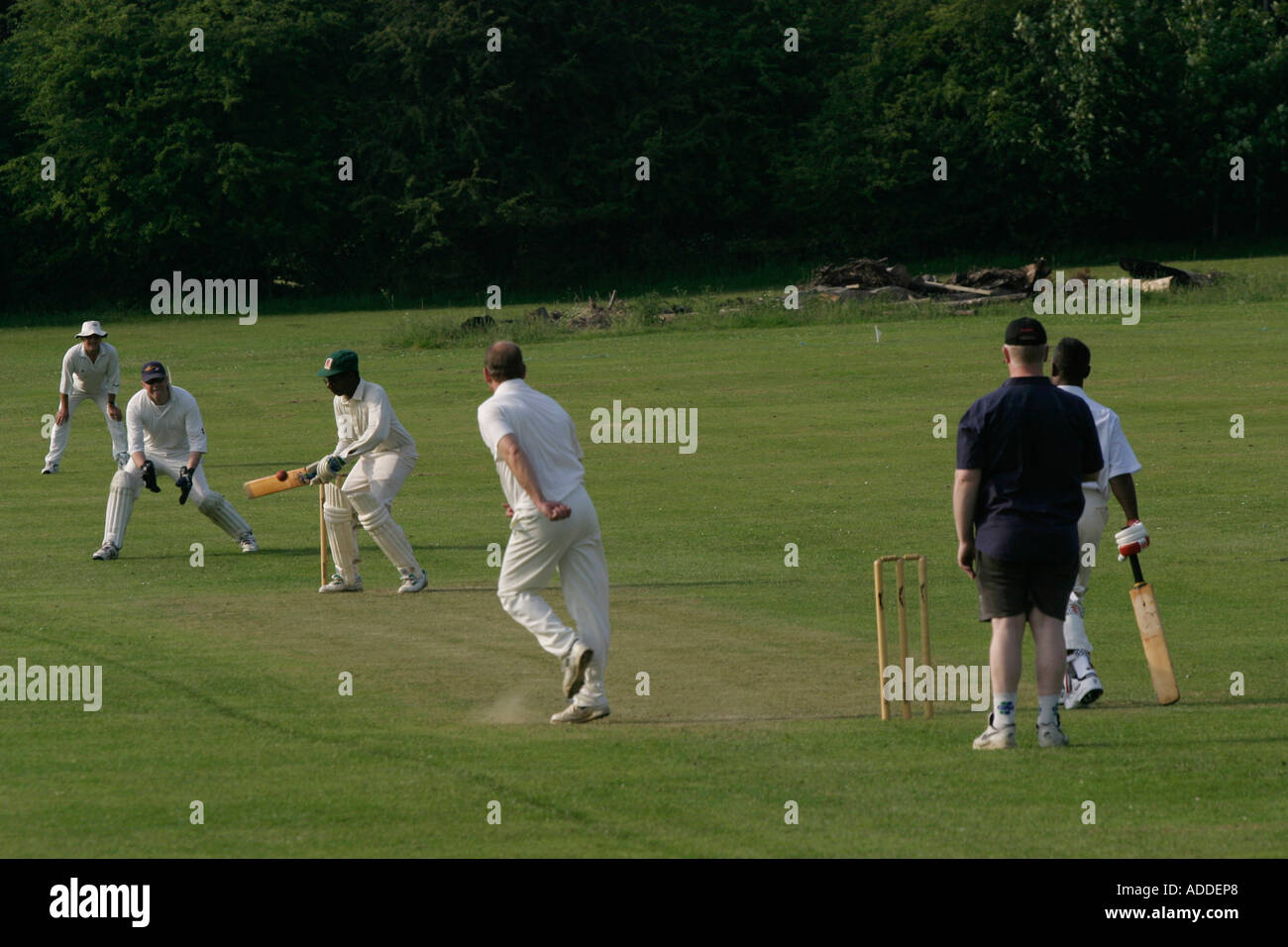 Playing cricket on the Hambleden village green - Stock Image