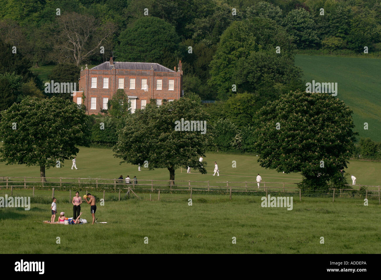 Family picnic in front of the Hamblen village playing fields - Stock Image