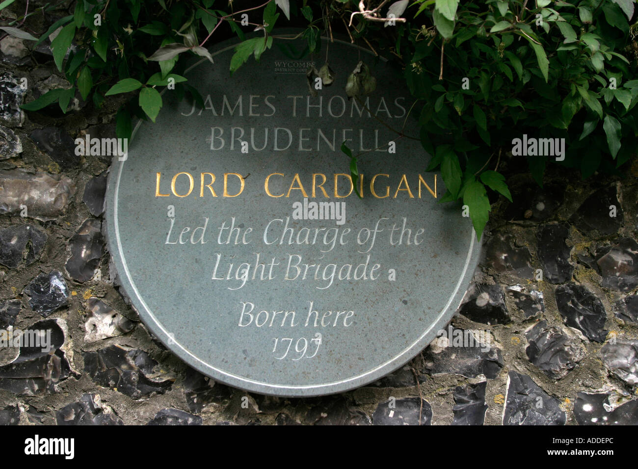 Cardigan plaque  outside the manor house where Viscountess Hambleden Henry Smith's mother lives. - Stock Image