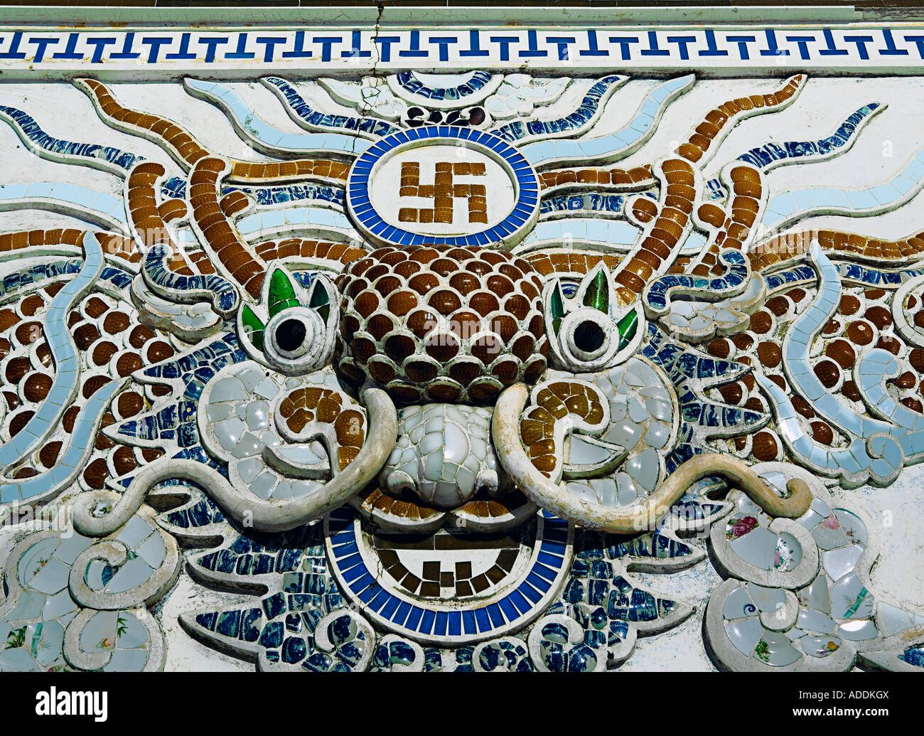 Mosaic panel of dragon and swastika at 'Long Son Pagoda', near 'Nha Trang', central Vietnam. - Stock Image