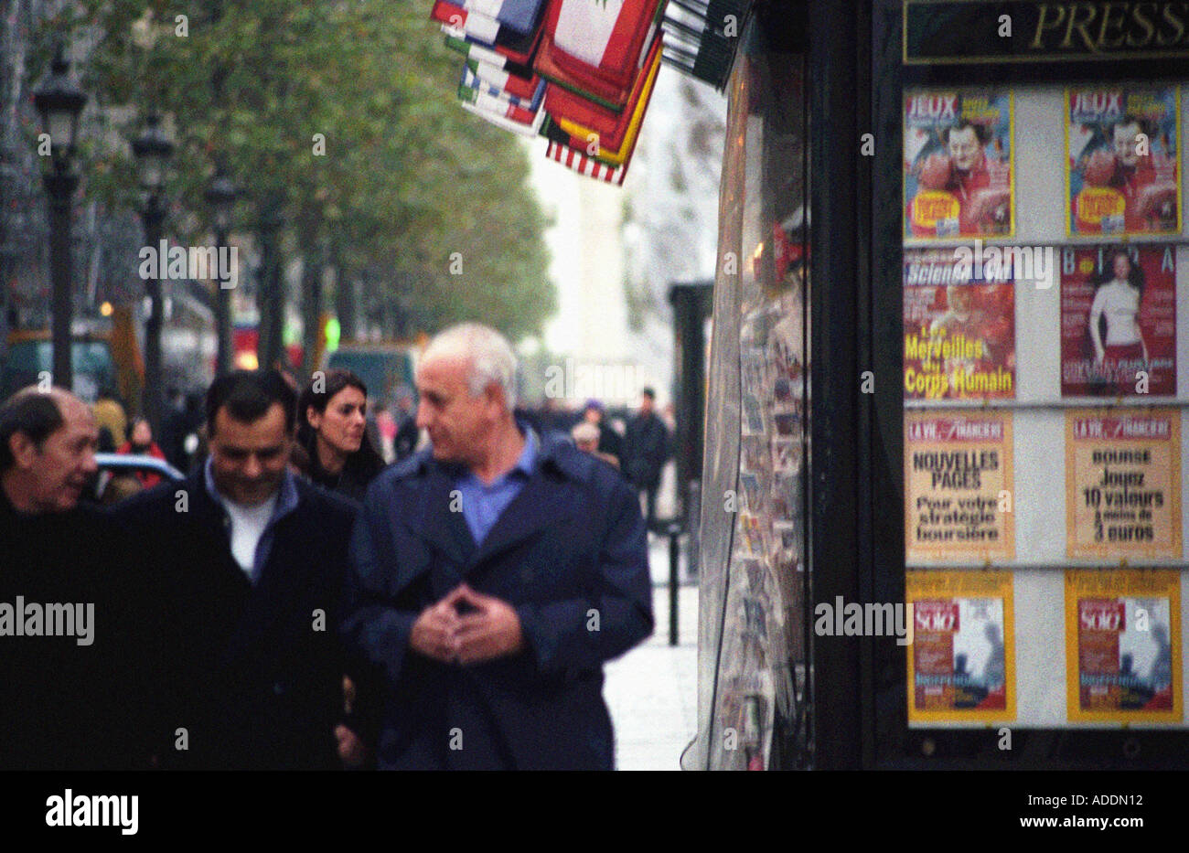A hazy shot of pedestrians walking along the Champs Elysées in Paris France - Stock Image