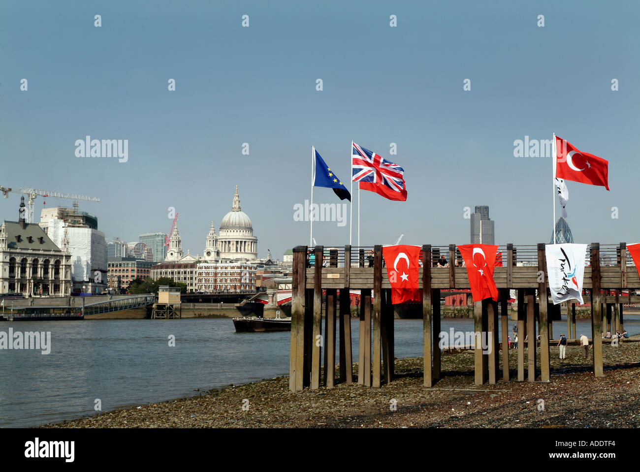TURKISH FLAG ALONGSIDE WITH UNION JACK AND EUROPEAN UNION FLAGS IN THE BANK OF THE RIVER THAMES LONDON 16 JULY 2005 - Stock Image
