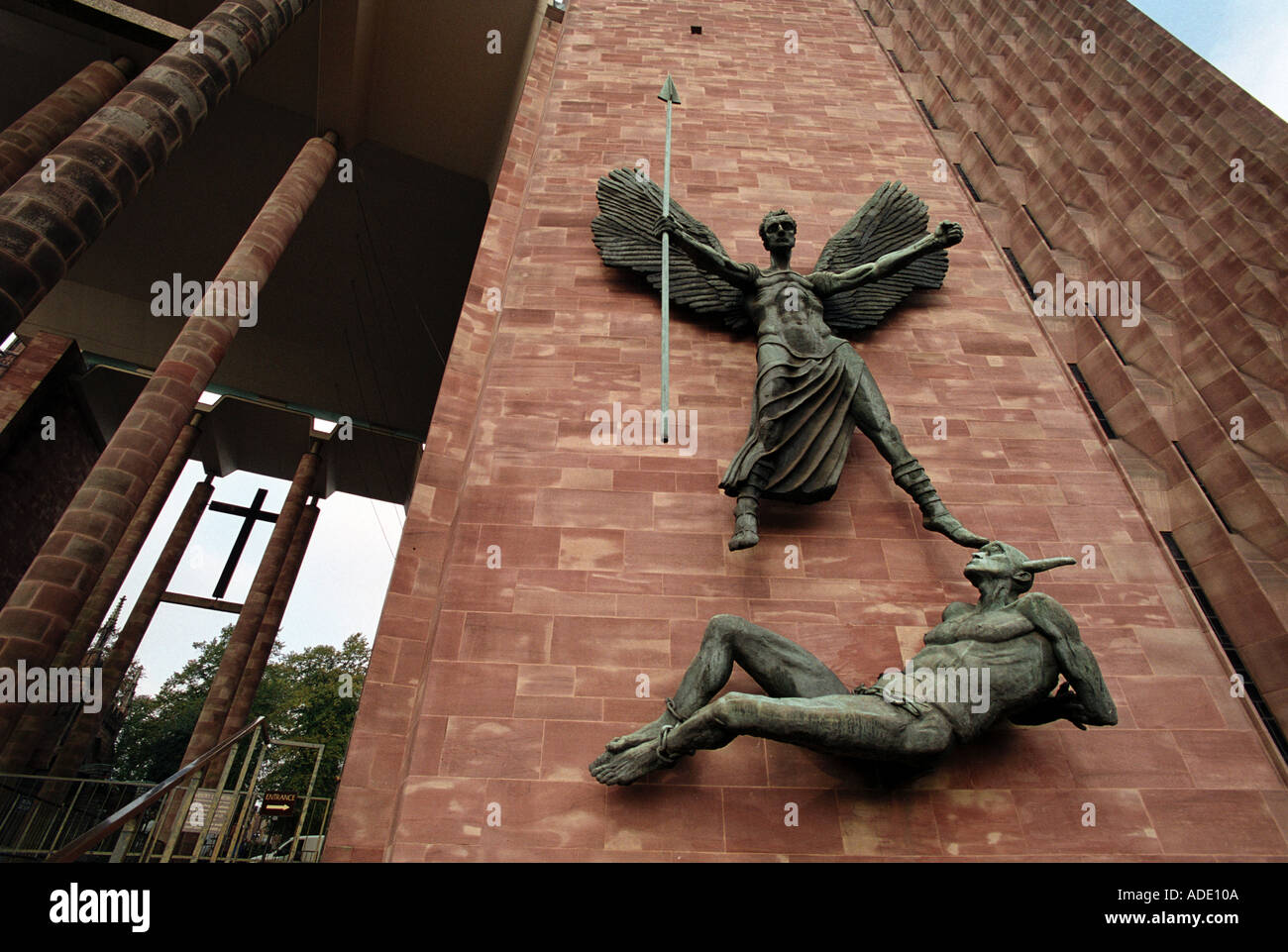 St Michael and The Devil by Jacob Epstein on the side of Coventry Cathedral England UK - Stock Image
