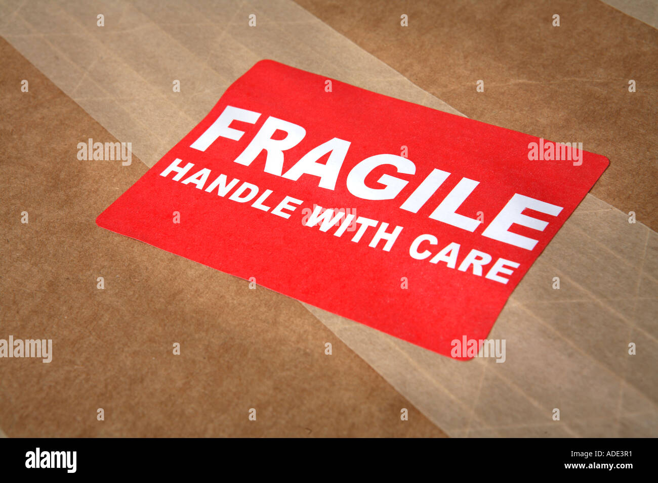Package with FRAGILE sticker - Stock Image