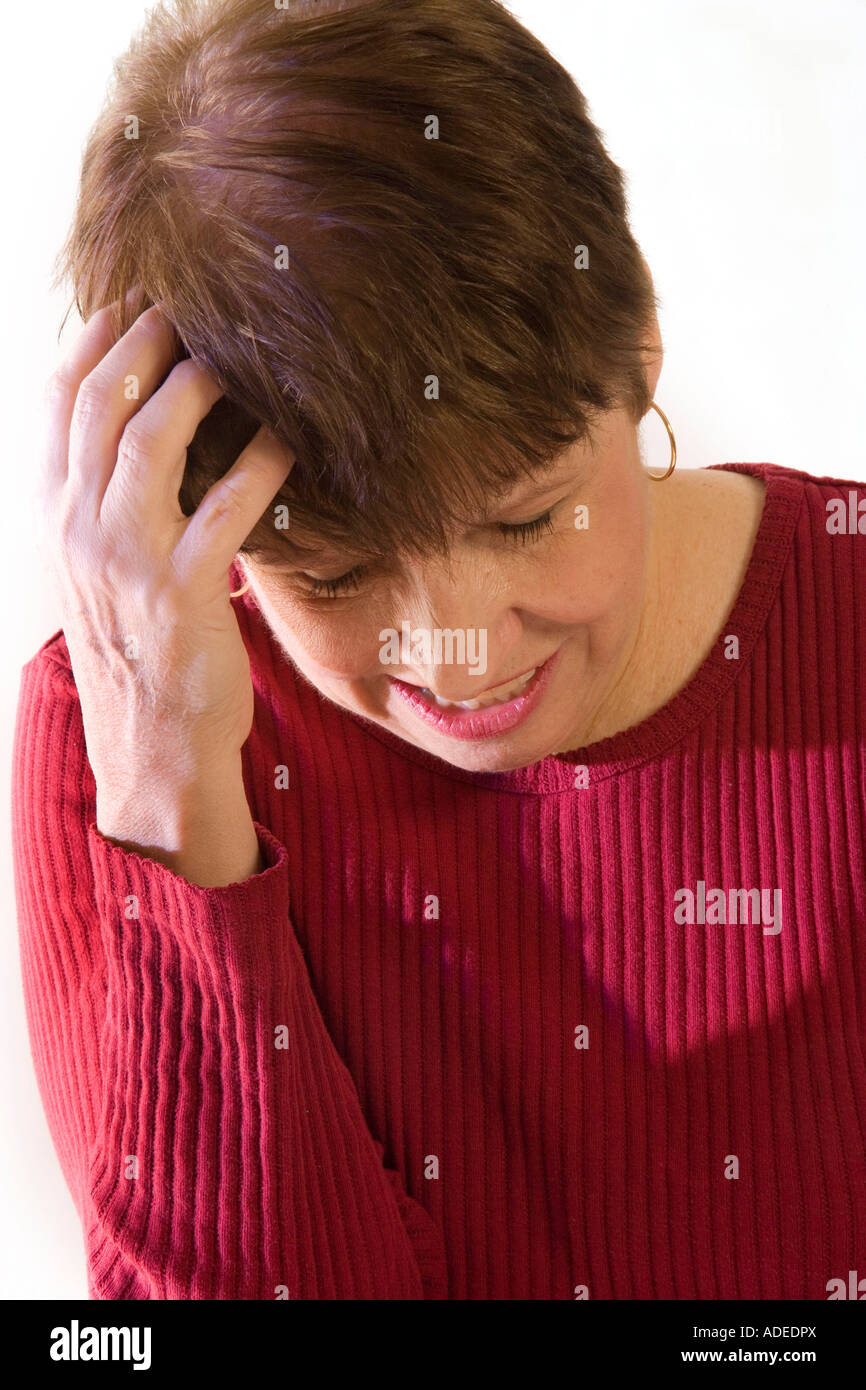Woman embarrassed or has headache. It has been a stressful day. - Stock Image