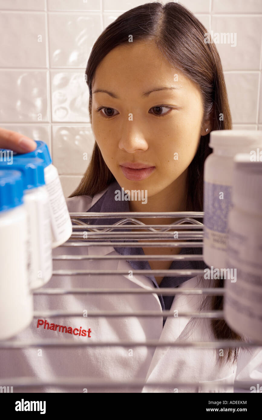 Pharmacist working in  retail store. - Stock Image