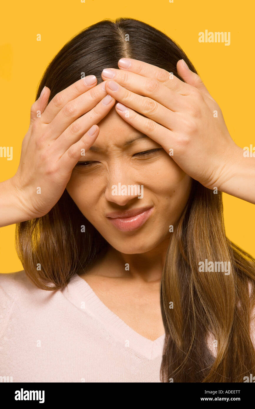 Woman with severe headache or stress. - Stock Image