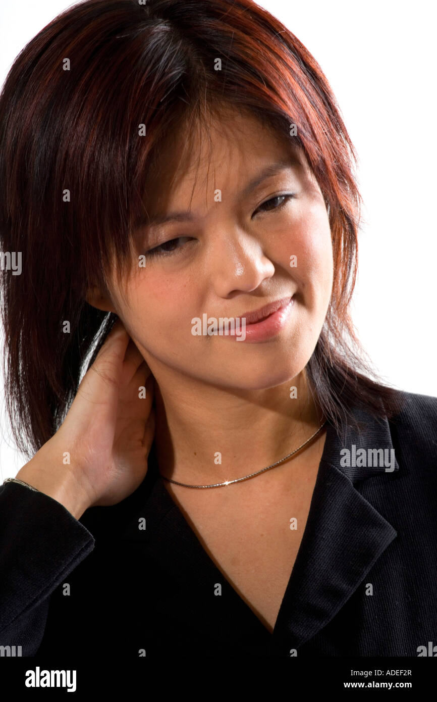 Woman with neck pain. - Stock Image