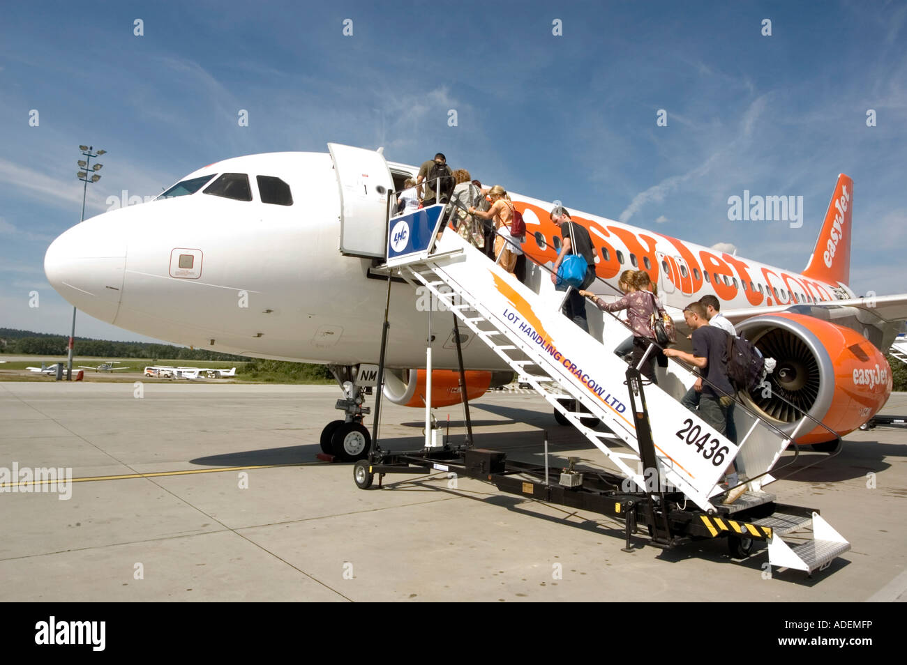 Passengers boarding easyJet aircraft at Cracow airport Poland - Stock Image