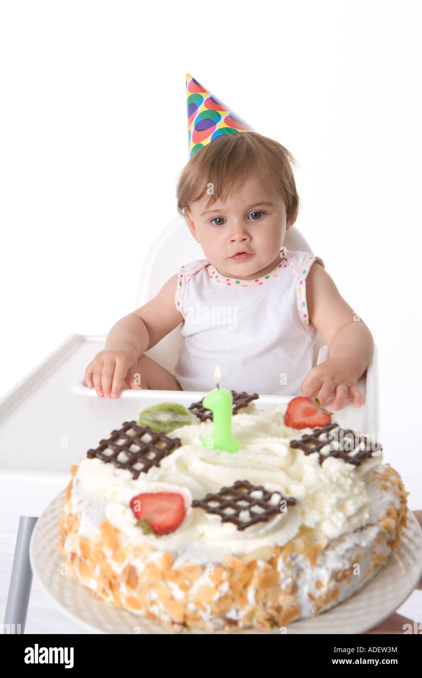 One Year Old Baby Girl Looking At Her Birthday Cake