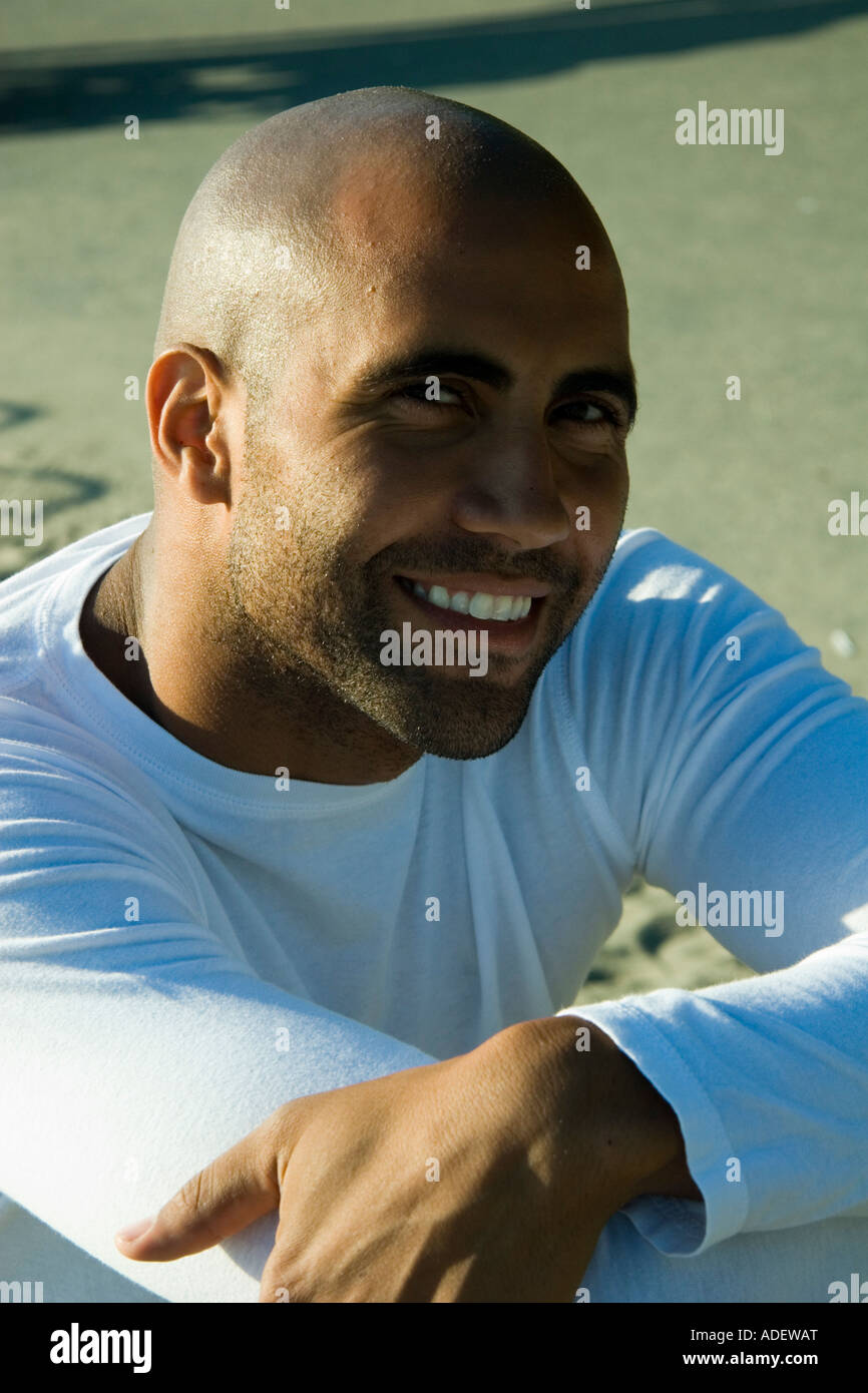 Close up of a smiling young black man - Stock Image