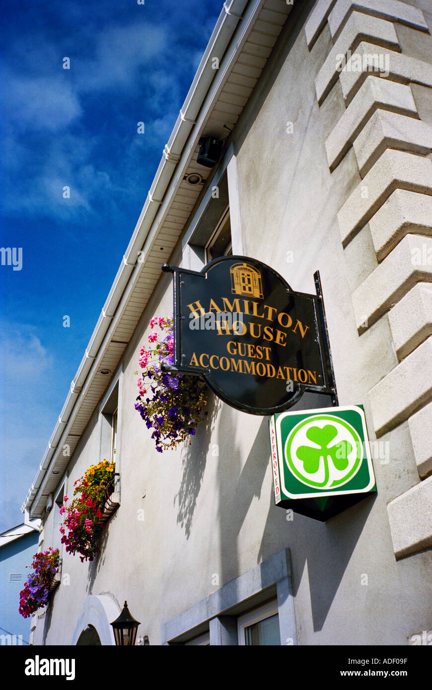 A bed and breakfast house in Ireland displaying the distinctive Bord Failte shamrock sign denoting it's official status - Stock Image