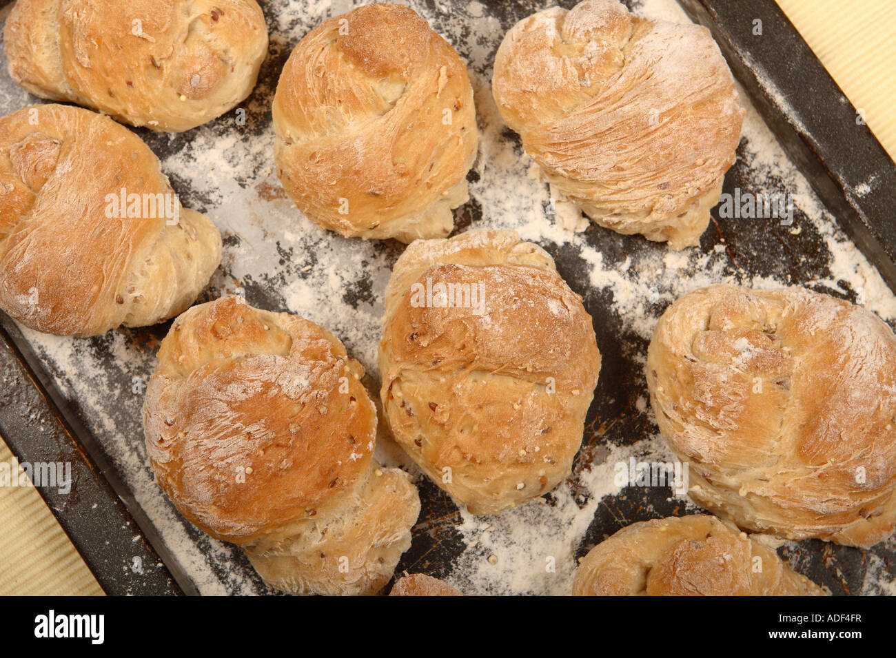 Home cooking fresh baked bread rolls on baking tray - Stock Image