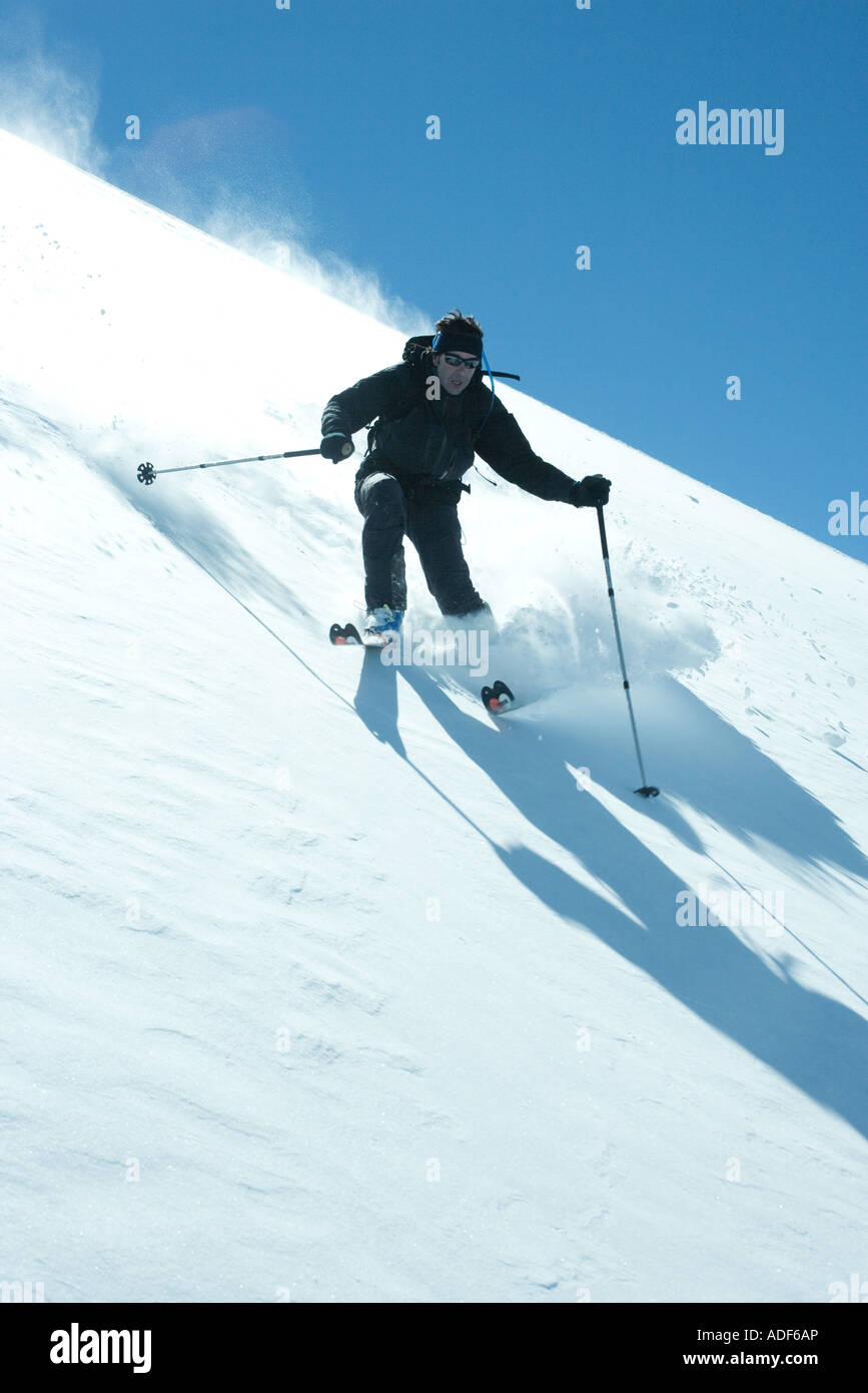 Skier coming downhill - Stock Image
