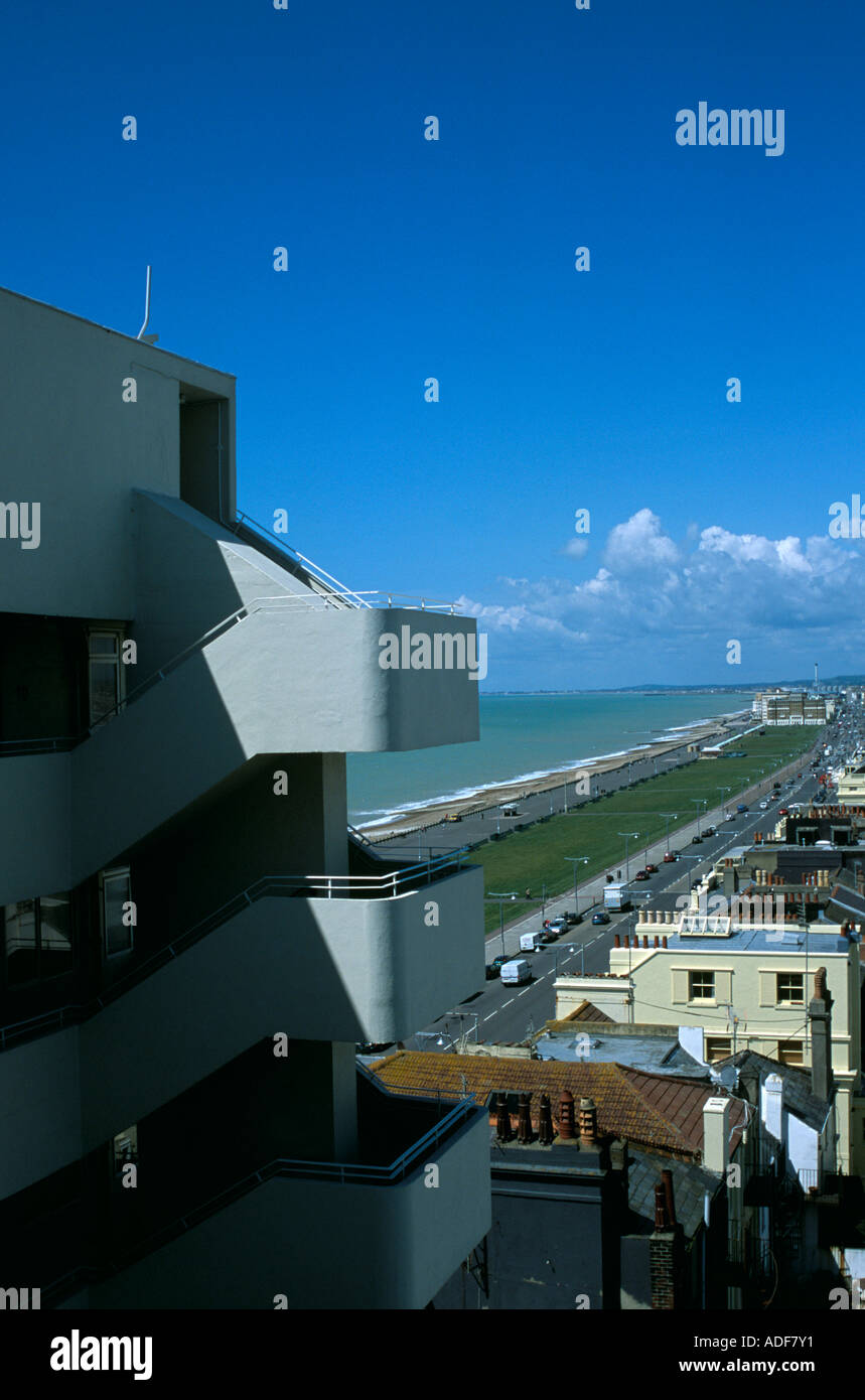 The rear access and cantilevered staircase at Embassy Court, Brighton with a view to the Hove seafront and promenade. - Stock Image