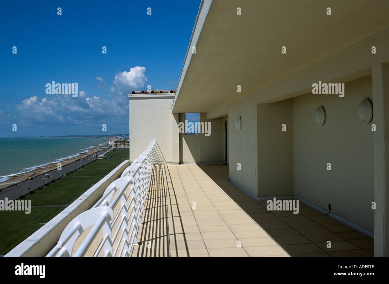 A view along the sun terrace of Embassy Court, Brighton, East Sussex looking towards the Hove seafront. - Stock Image