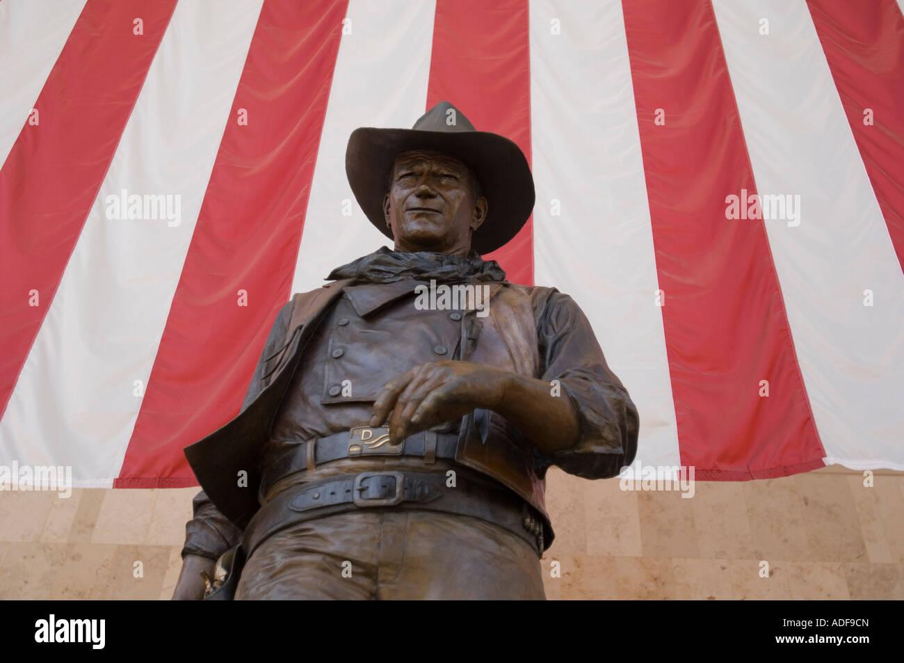 Giant stature of John Wayne welcomes passengers to the Orange County John Wayne Airport in Southern California - Stock Image