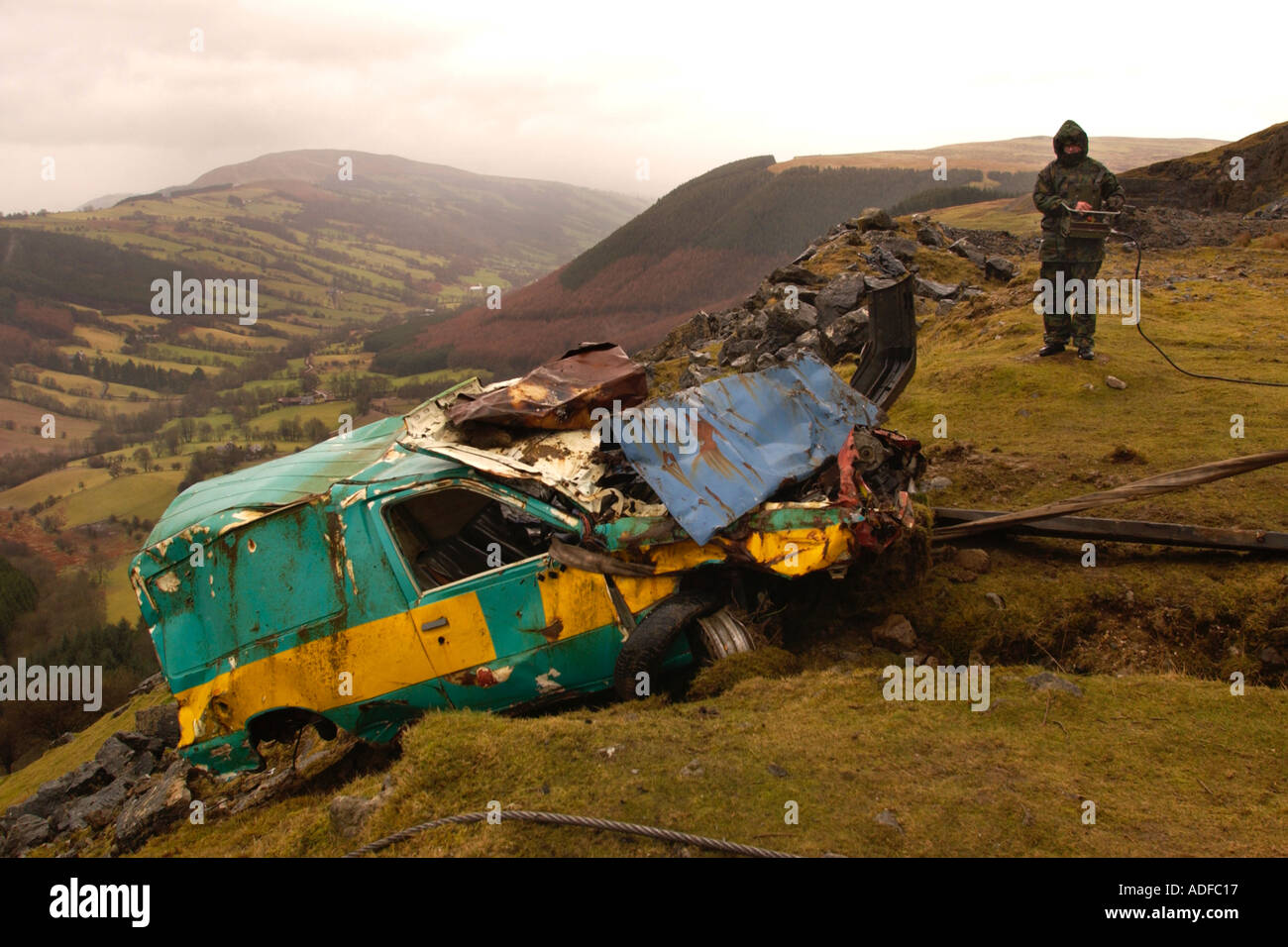 Environmental cleanup of vehicles dumped at Ystrad Quarry in the Brecon Beacons National Park near Trefil South Wales UK - Stock Image