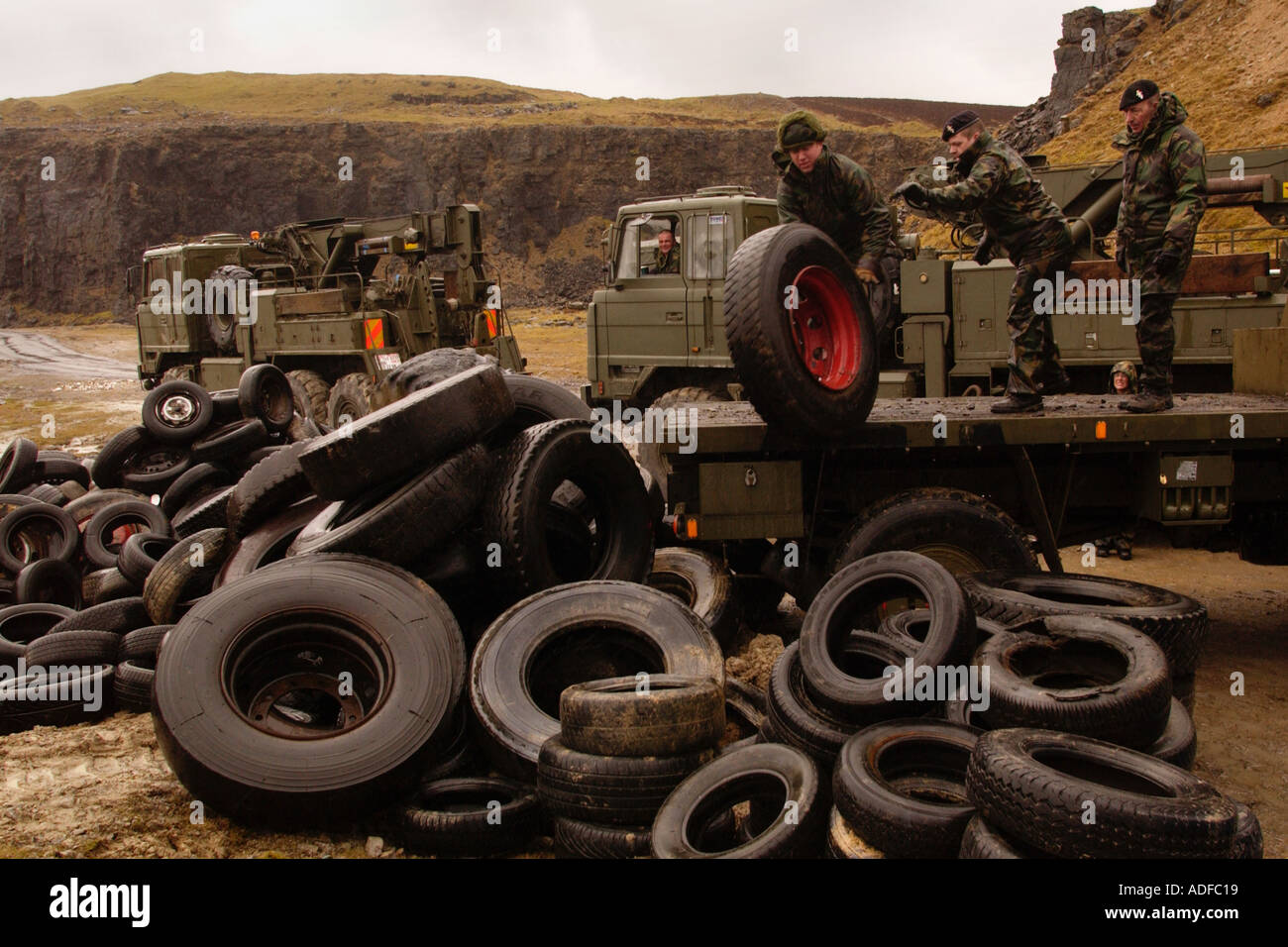 Environmental cleanup of vehicle tyres dumped at Ystrad Quarry in the Brecon Beacons National Park near Trefil South Wales UK - Stock Image