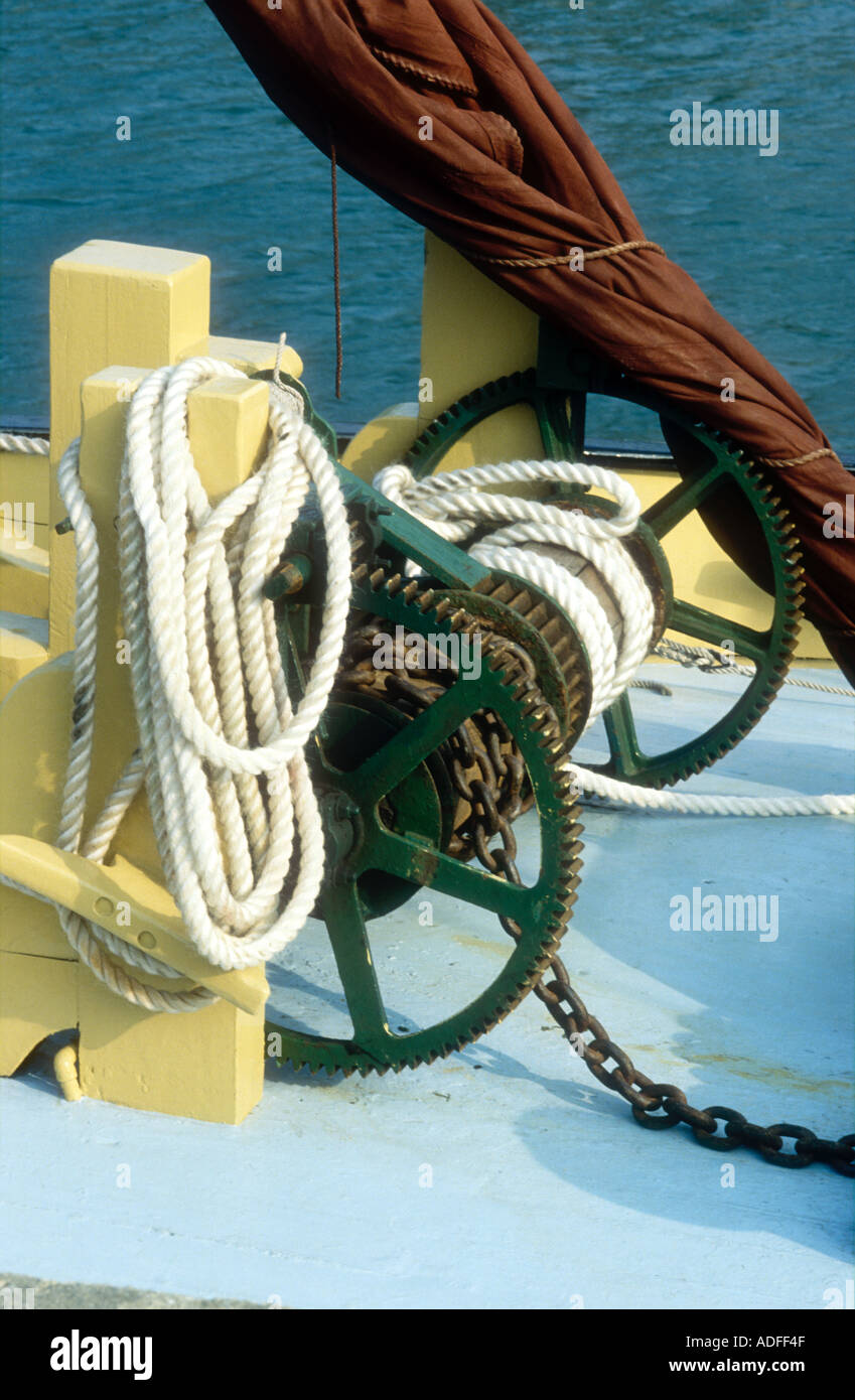 A deck winch aboard a Thames sailing barge - Stock Image