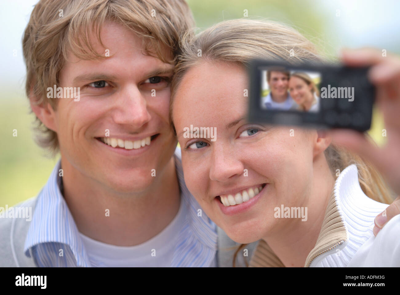 Young couple taking self portrait photograph Stock Photo